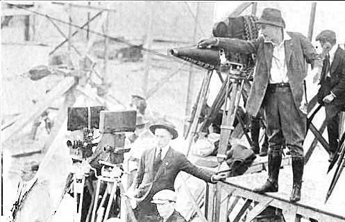 Photo of DeMille at work in silent film era