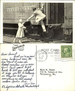 postcard of the Aces hopping a freight car