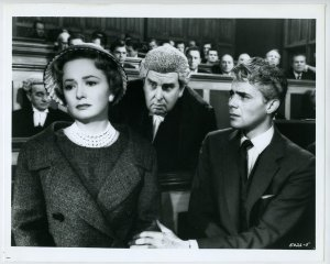 courtroom scene with wife, barrister, and husband